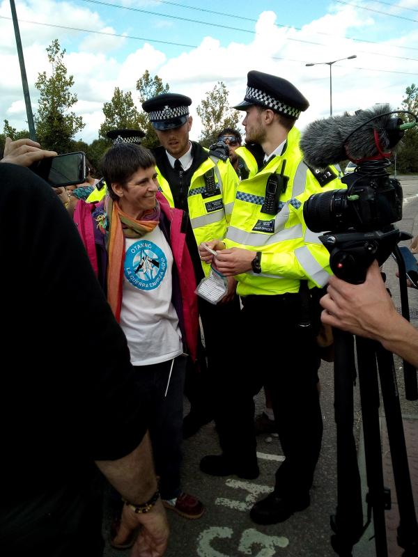 WRI member Koldobi Velasco blockading the road entrance to prevent equipment being brought in to DSEI