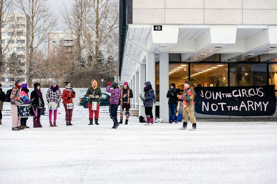 activists in FInland protesting in front of a recruitment centre as part of International Week of Action Against the Militarisation of Youth