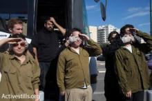 Hear no evil, see no evil, speak no evil: Activists in Israel dress as soldiers to take part in a protest, in solidarity with imprisoned conscientious objectors
