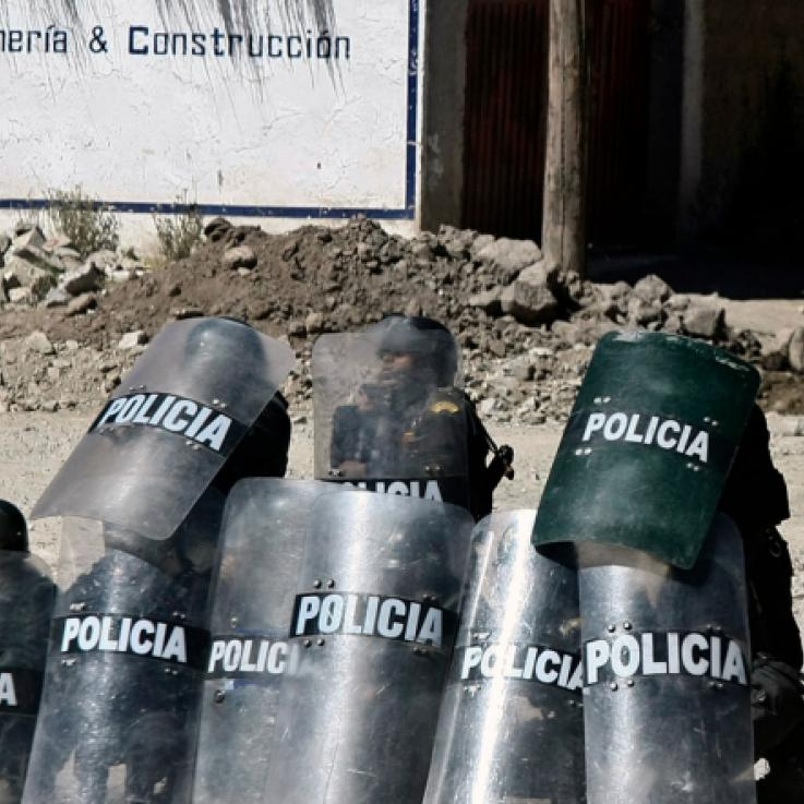 Police holding shields in front of the Tintaya mine in Peru